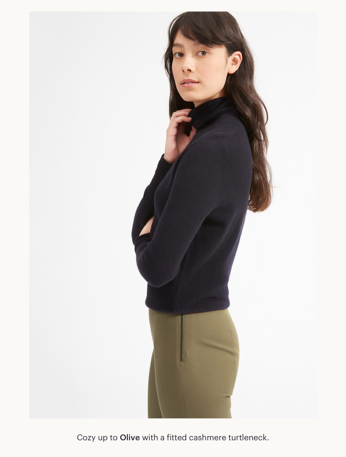 Cozy up to Olive, with a fitted cashmere turtleneck.