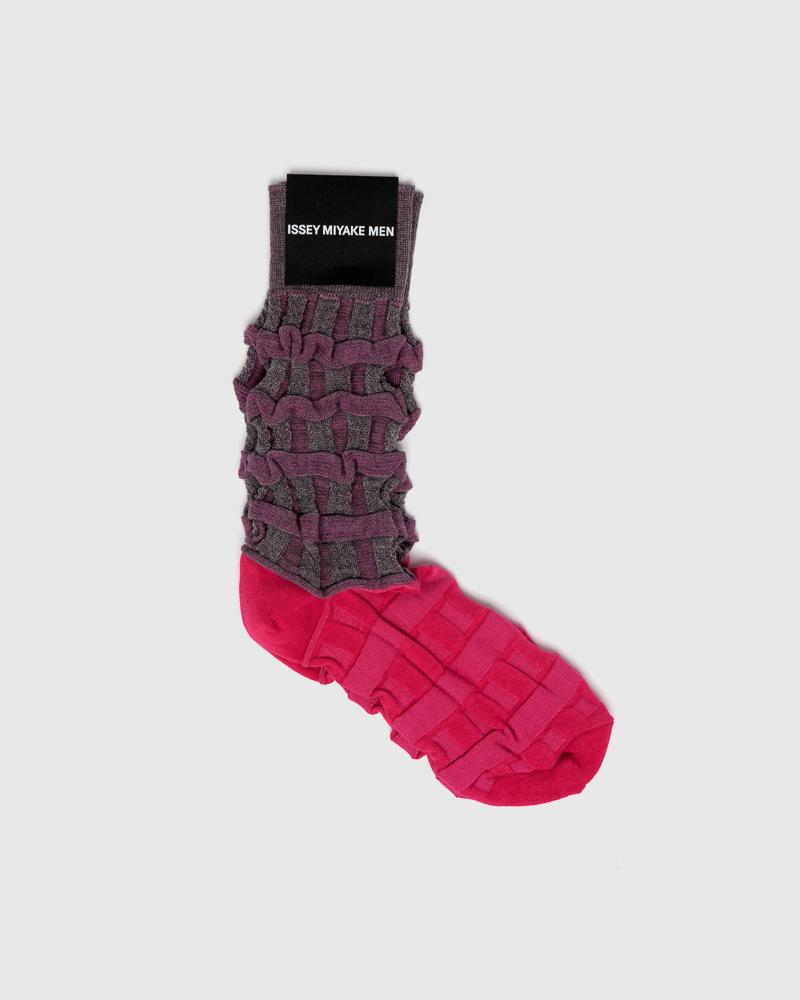 Two tone color socks in magenta by Issey Miyake